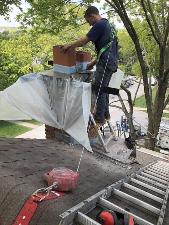 Technician Replacing a Chimney Crown Cap