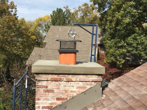 Merriam Brick Chimney - New Overhanging Crown Replacement by Full Service Chimney Sweeps