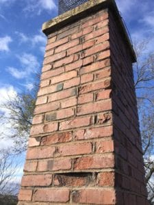 Masonry Chimney with Damaged Brickwork needs repair In Osawatomie