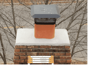 After flue fire in Olathe Kansas Full Service Chimney seals the crown