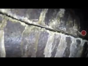 This is an Image of missing mortar joints in a masonry fireplace, this can pose a fire hazard