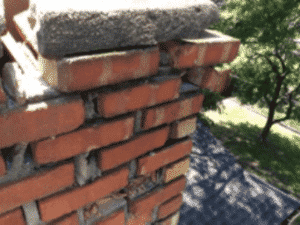 Storm damage of chimney crown before rebuild