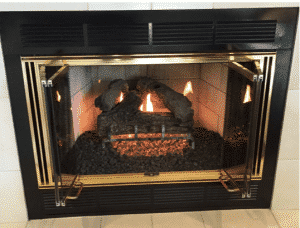 Here is the fireplace after we refreshed and replaced the gas logs