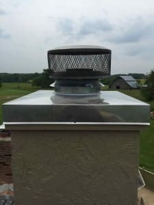 Prefab chimney chase cover after new stainless steel chimney cover is installed