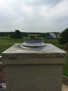Prefab chimney chase cover before new stainless steel chimney cover is installed