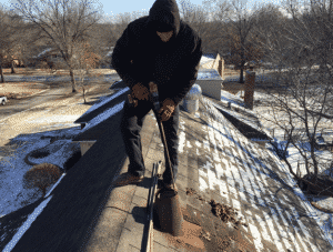 Technician cleaning utility flue