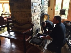 Jake and Sam completing a yearly inspection on customer's masonry heater