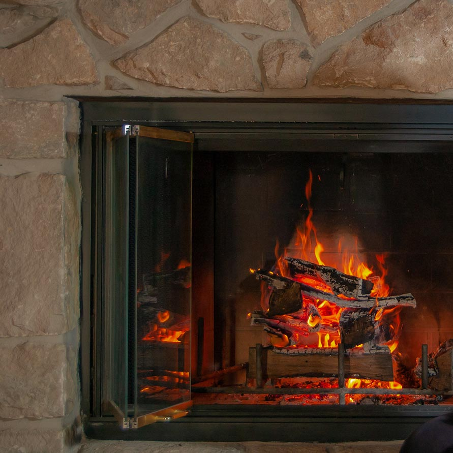 Fire in Wood Burning Fireplace Adds Warm Ambiance to Home Hearth