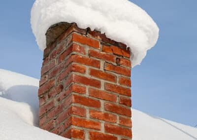 Snow Covered Brick Chimney in Winter