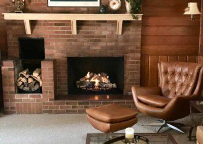 firewood next to fireplace brick hearth