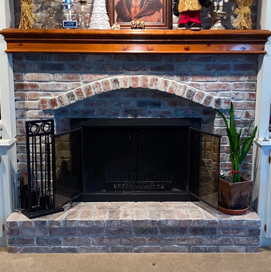 Antique Looking Brickwork with Black Firebox