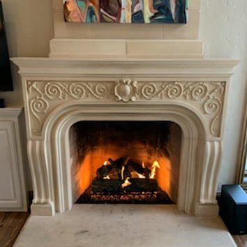 Fancy Surround Mantel with fire burning