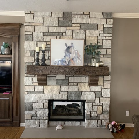 Stone Fireplace Surround with Wooden Mantel and horse painting