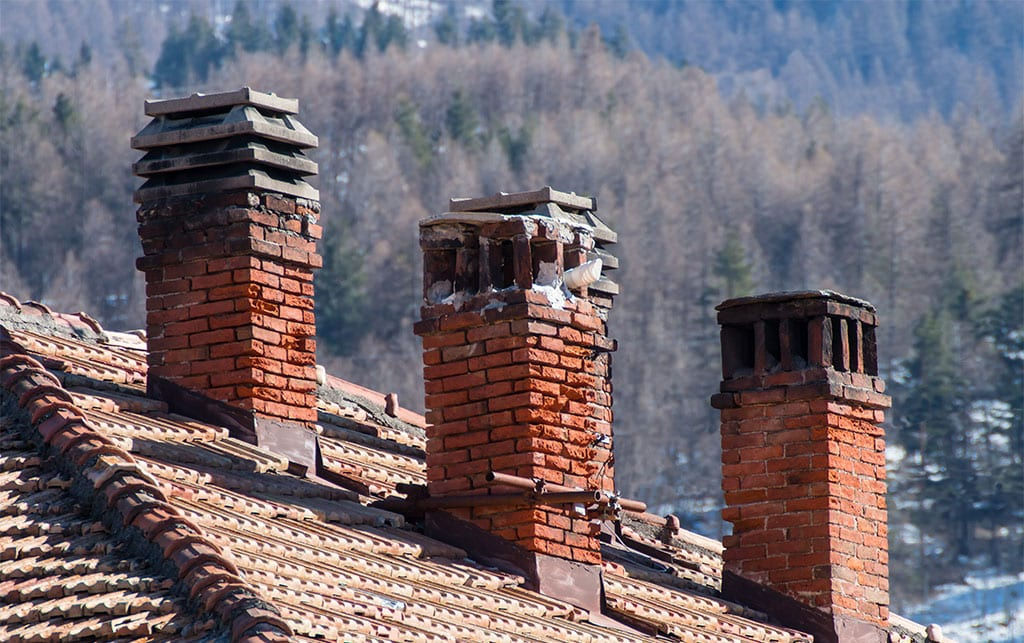 Red clay tile roof and brick smoke stack
