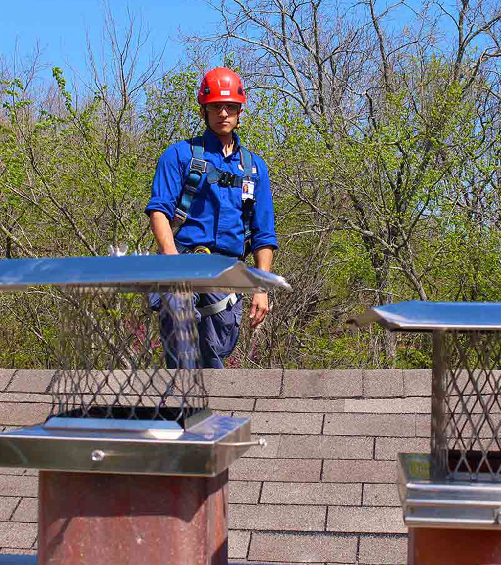 Chimney Repair Technician on Roof