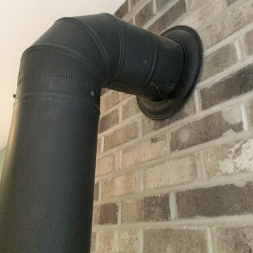 Wood Stove Pipe into Brick Surround Wall