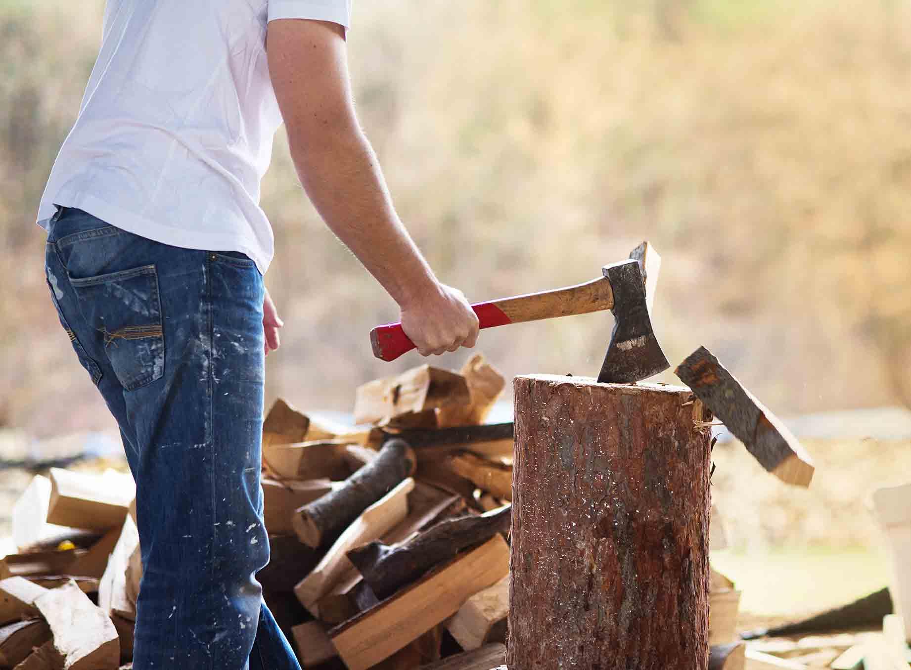 person-chopping-wood-in-backyard