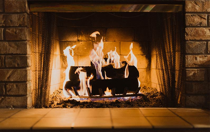 dark burning fireplace flames