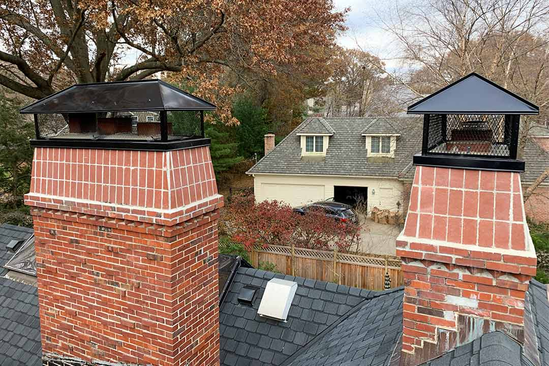 Two Black Stainless Steel Chimney Caps
