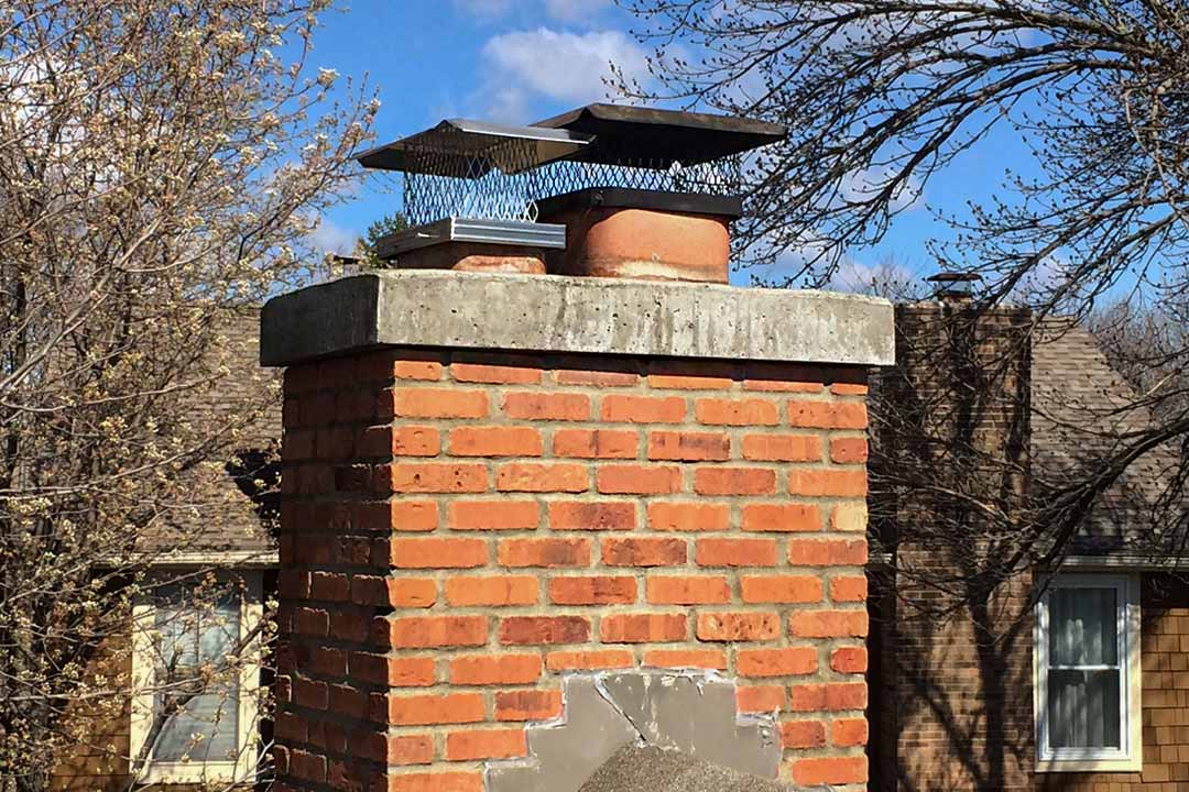 Brick Chimney Rebuild and Stainless Steel Cap Installation