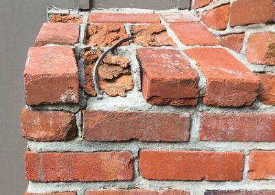 Damage to Shoulder of a Brick Chimney