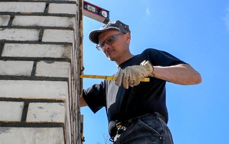 Full Service Chimney™ Owner performs Brick Chimney Repairs in Kansas City