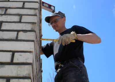 Full Service Chimney Owner Inspecting Chimney