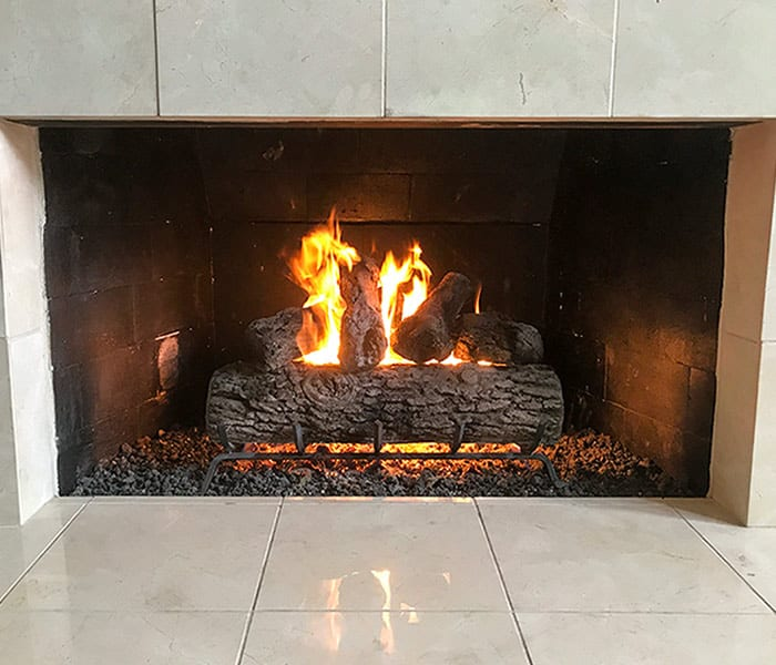 Gas logs in a Kansas City Fireplace with Marble Surround