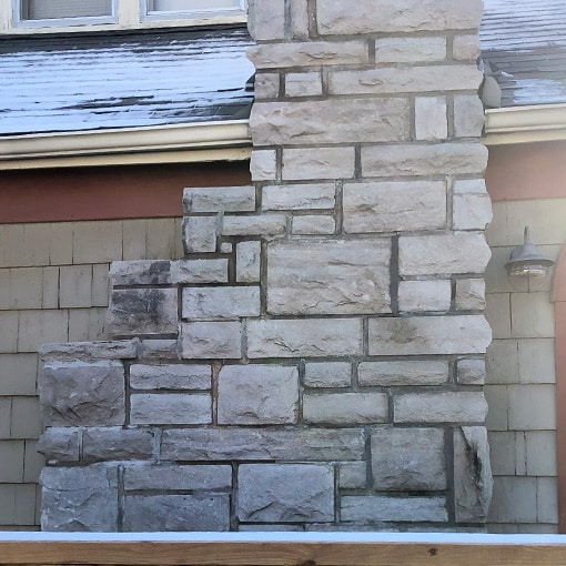 Black stains on stone chimney