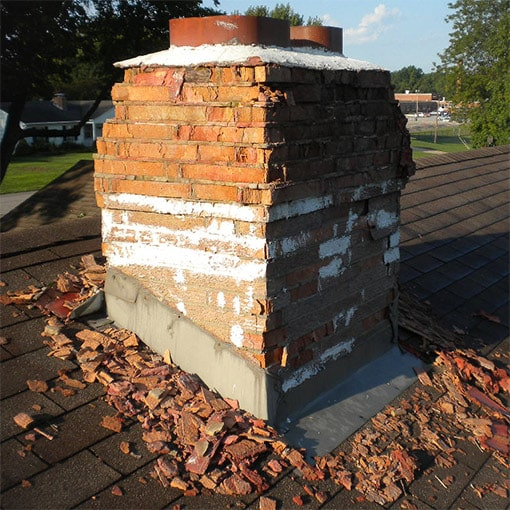 Spalling chimney with efflorescence