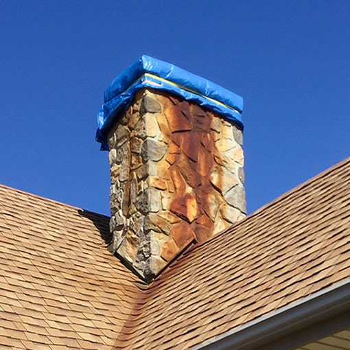 Red chimney staining down onto roof