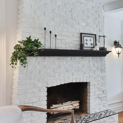 White painted brick fireplace mantel surround