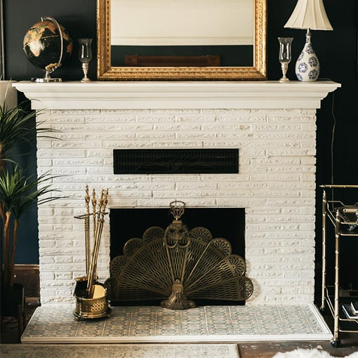 Painted White Brick Fireplace with Decorative Brass Metal Screen
