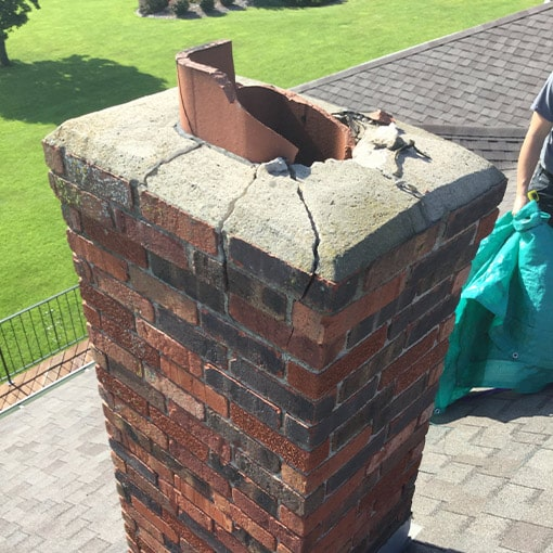 Damaged Flue Tile and Crown in Paola