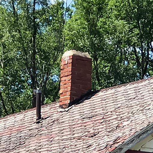 Damaged Masonry Chimney in Paola
