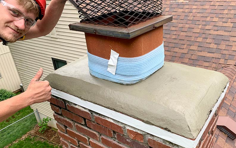 Chimney Crown Wash Repair Technician Giving a Thumbs Up for a construction job well done
