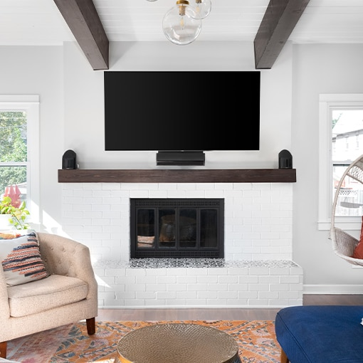Mounted TV Above Brick Fireplace