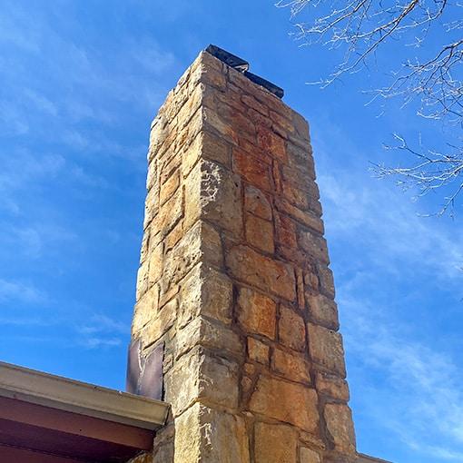 Rust Streaks on Stone Chimney