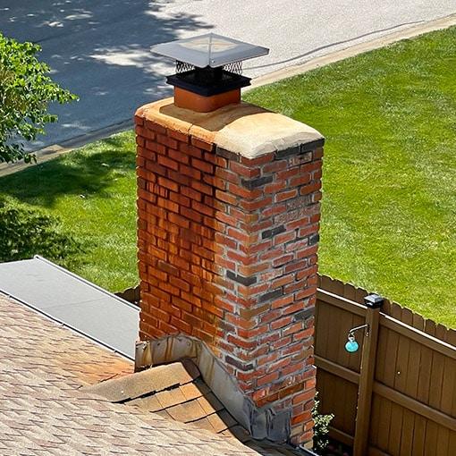 Roof Rust Streaks on Masonry Chimney