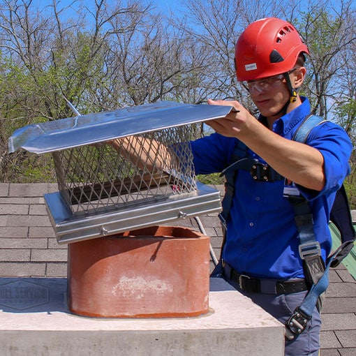 Prevent raccoon in chimney with a cap installation