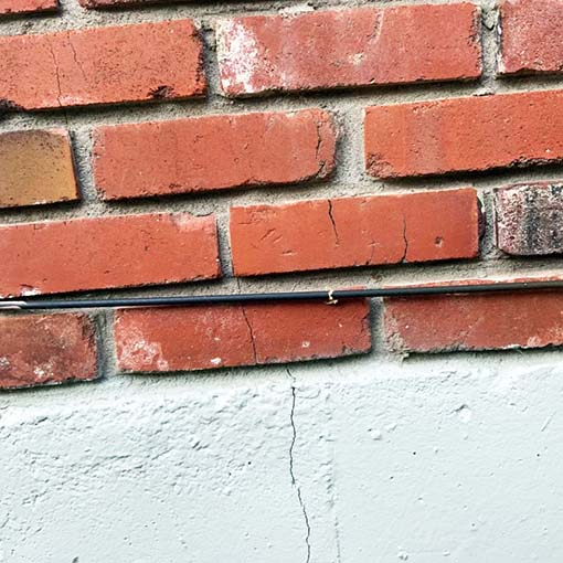 chimney bricks cracking into a homes chimney and foundation