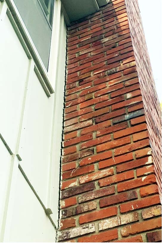 chimney pulling away from house side wall