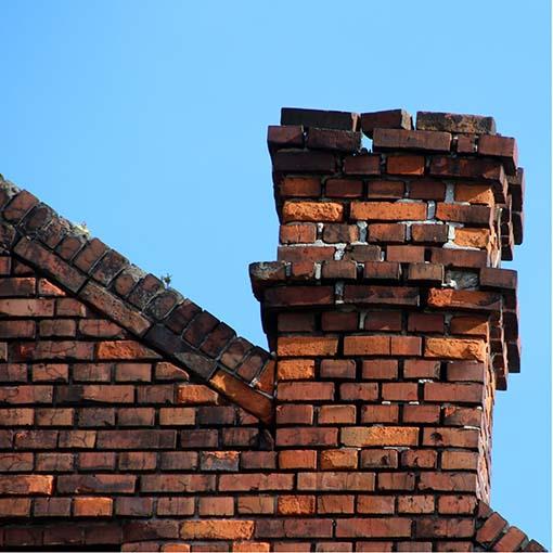 broken brick chimney tilting